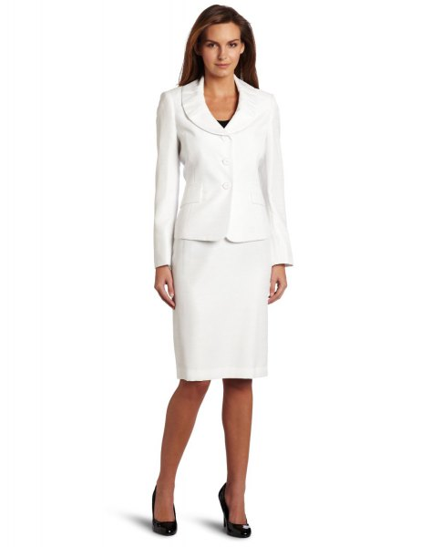 white suite jacket with a knee-length, straight-cut dress and black heels
