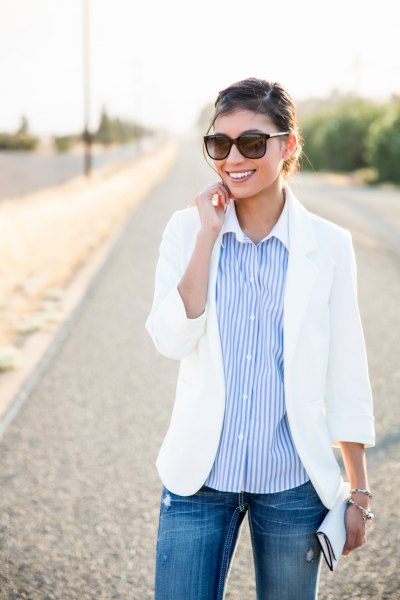 white summer blazer with a relaxed fit and a sky-blue striped shirt with buttons