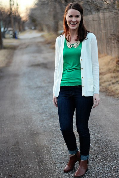 white cardigan with green blouse with scoop neckline and ankle jeans