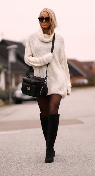 white sweater dress with stockings and knee-high black boots