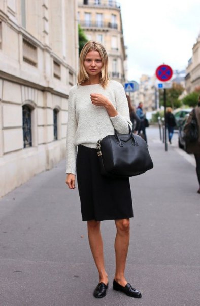 white sweater with black knee-length skirt and leather penny shoes