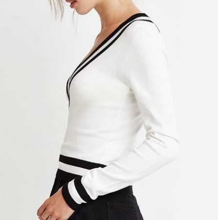 white sweater with black minirater skirt
