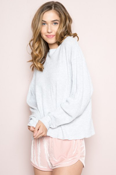 white sweater with blushing pink mini silk shorts