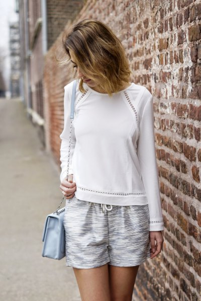 white sweater with flowing silver metallic shorts