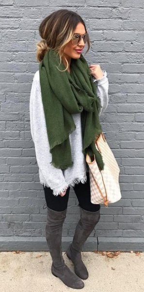 white sweater with a green scarf and gray overknee boots