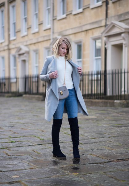 white sweater with gray long coat and blue high jeans