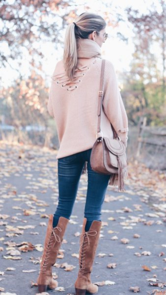 white sweater with high lace-up boots
