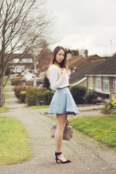 white sweater with light blue, high-waisted mini skirt