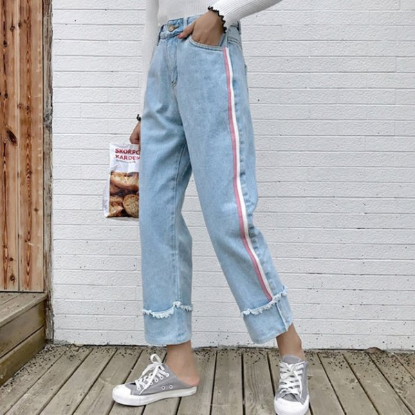 white sweater with light blue, pleated, cropped jeans and gray canvas sneakers