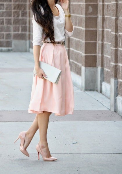 white sweater with a light yellow midi skirt and blushing heels