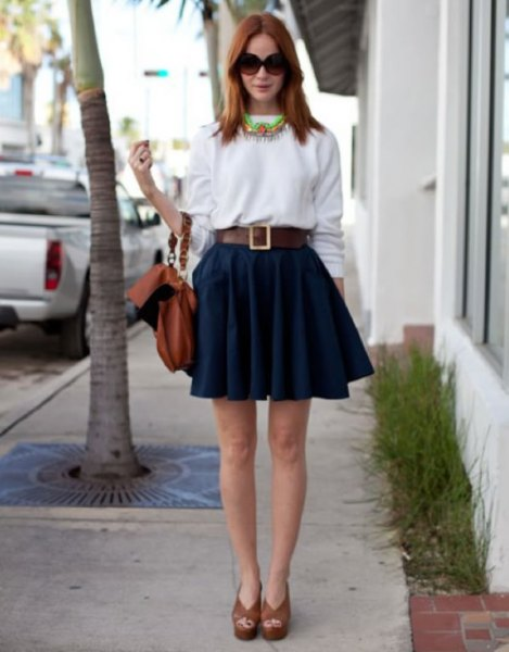 white sweatshirt with dark blue mini pleated skirt and belt