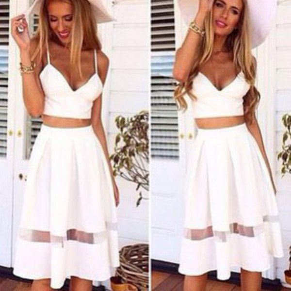 white, figure-hugging crop top with a high, flared midi skirt