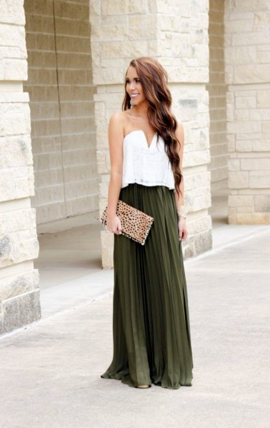 white blouse with sweetheart neckline and dark green pleated skirt
