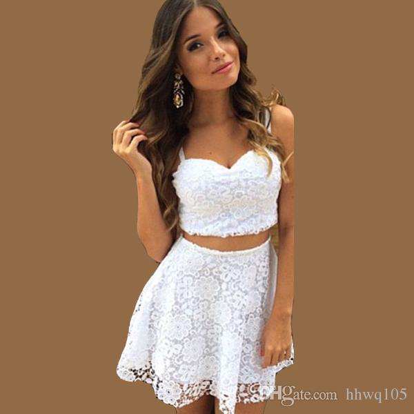 white crop top with sweetheart neckline and mini lace skirt