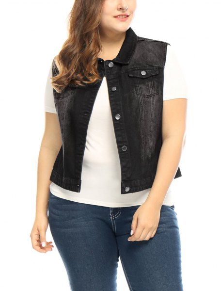 white t-shirt with black denim vest and dark blue skinny jeans