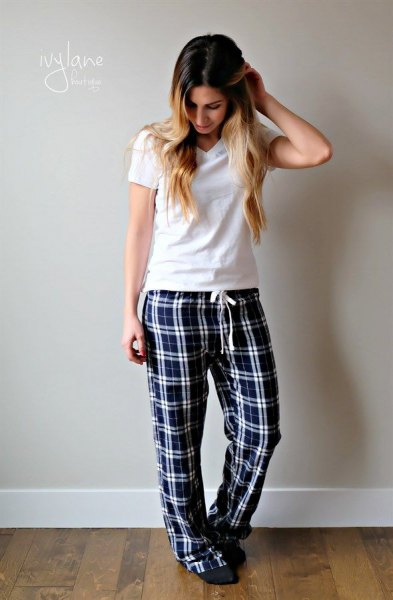 white t-shirt with black checked pajama pants