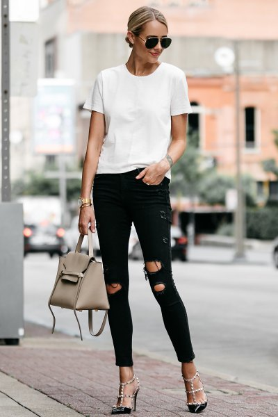 white t-shirt with black skinny jeans and strappy heels