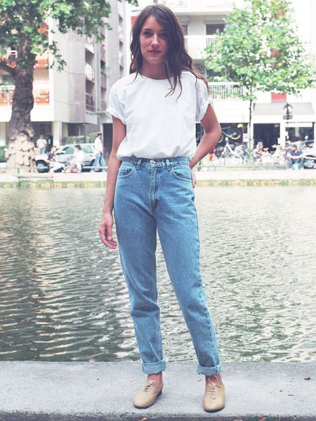white t-shirt with blue vintage high-waisted jeans