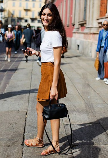 white t-shirt with brown suede mini skirt and sandals