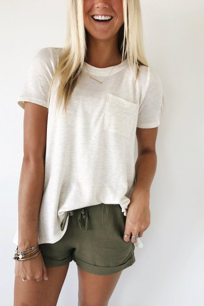 white t-shirt with green shorts with cuffs