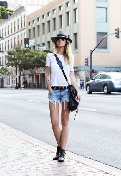 white t-shirt with light blue denim shorts and gray hat