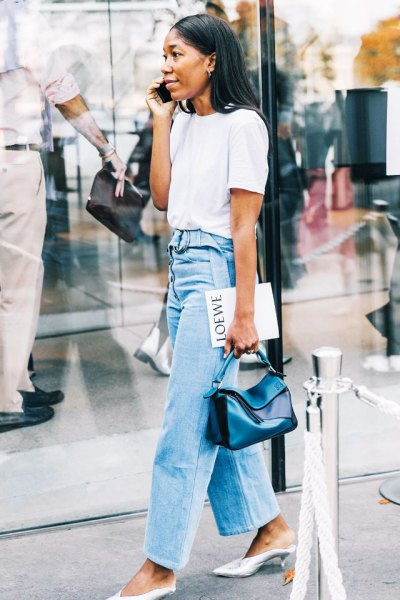 white t-shirt with light blue high-rise jeans with wide legs