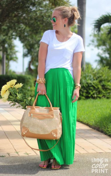 white t-shirt with a light green maxi pleated skirt