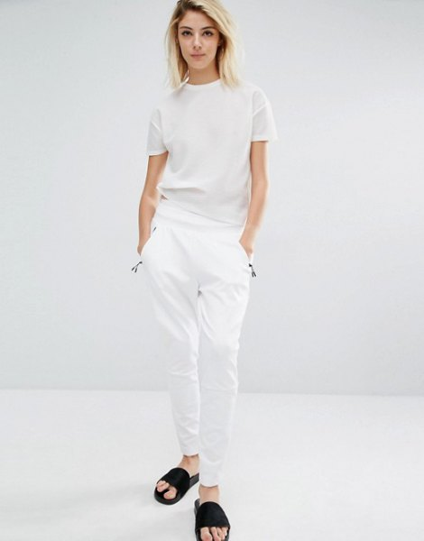white t-shirt with matching pants and black sandals