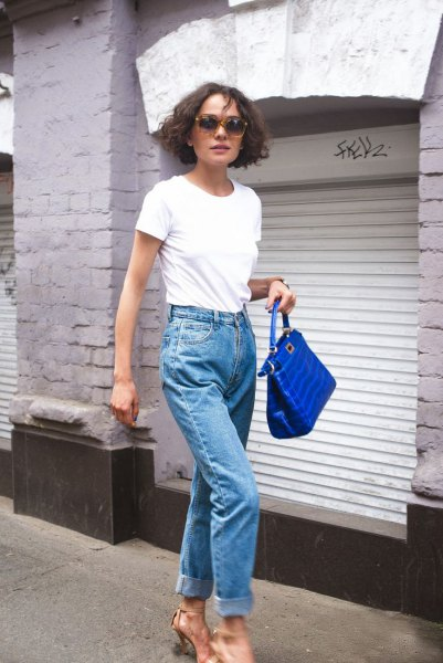 white t-shirt with mom jeans and royal blue leather handbag
