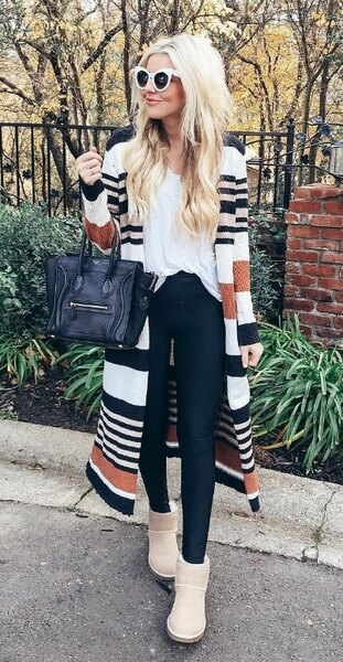 white t-shirt with multicolored striped longline coat and snowshoes