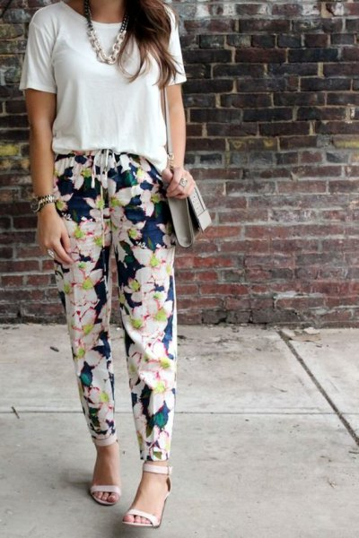 white t-shirt with dark blue floral trousers