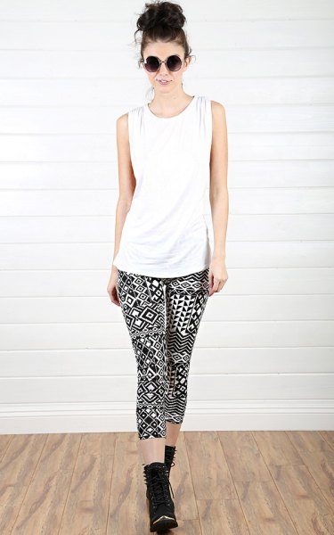 white tank top with black leggings with tribal print