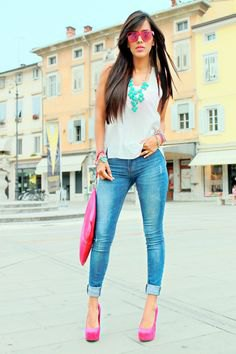 white tank top with blue skinny jeans with cuffs and pink platform heels
