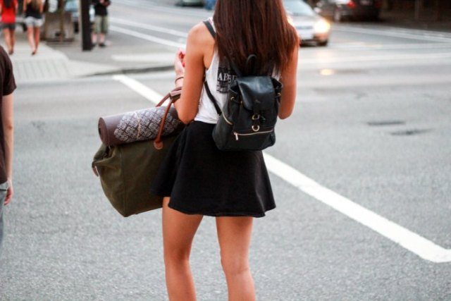 white tank top with mini pirate skirt and black wallet