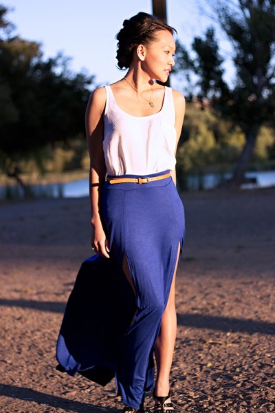 white tank top with yellow belt and blue, high split skirt