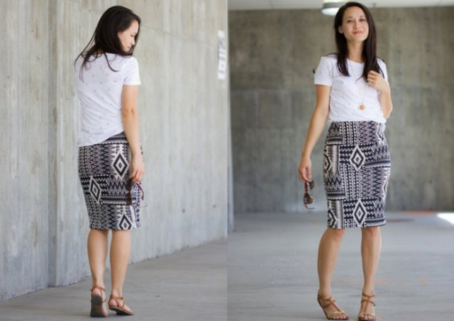 white t-shirt with knee-length knitted skirt with black and white tribal print
