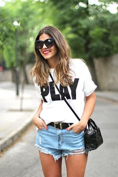 white t-shirt with light sky blue denim shorts and black leather belt