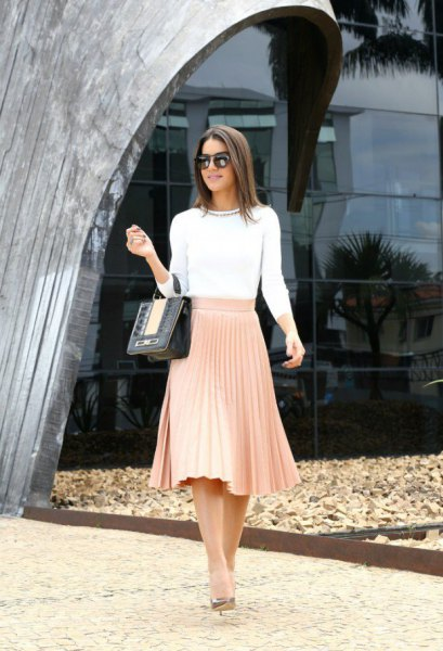 white sweater with three-quarter sleeves and red pleated midi skirt