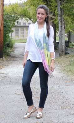 white t-shirt with three-quarter sleeves, skinny jeans and gold slippers