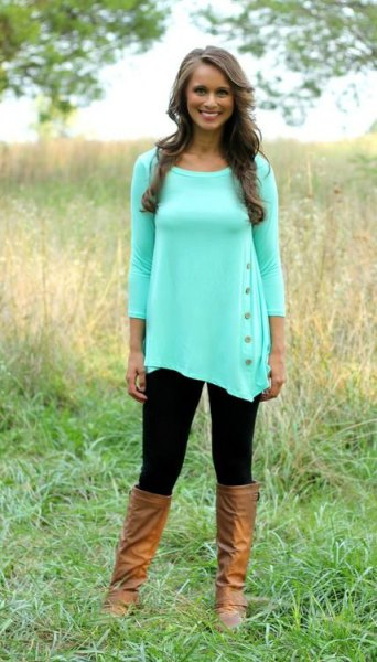 white tunic blouse with three-quarter sleeves and knee-high leather boots