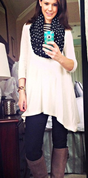 white tunic top with three-quarter sleeves and black infinity scarf with polka dots