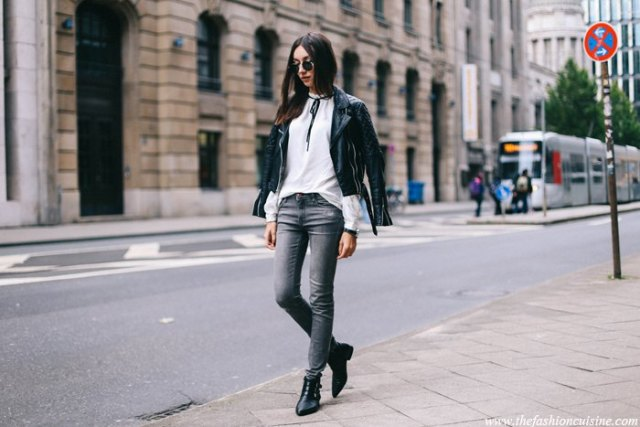 white tie neck blouse black moto jacket gray jeans