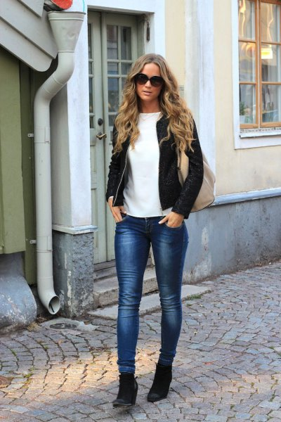 white top and black bomber jacket