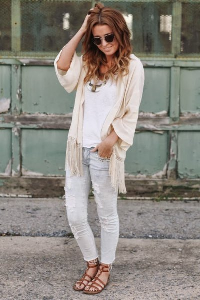 white top with ivory cape with half sleeves and light gray jeans