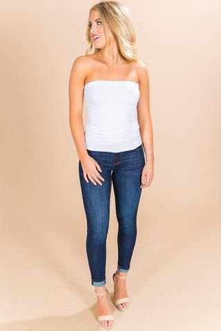 white tube top with dark blue tube jeans with cuffs