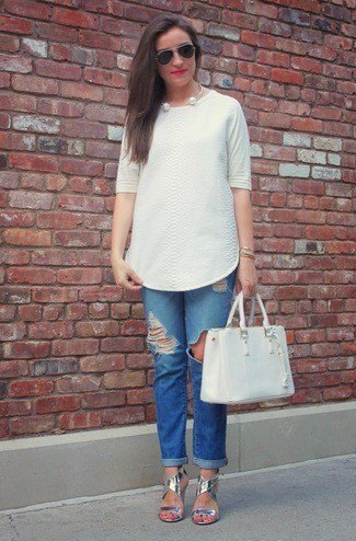 white tunic blouse with blue jeans with cuffs and silver sandals