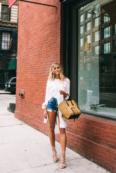 white tunic shirt with buttons and blue denim shorts