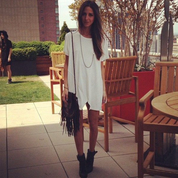 white tunic dress with fringed pocket and boots