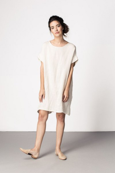white tunic dress with light pink leather flats