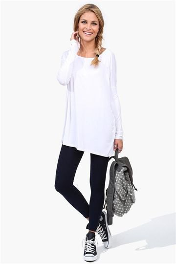 white tunic long-sleeved T-shirt with black ankle jeans